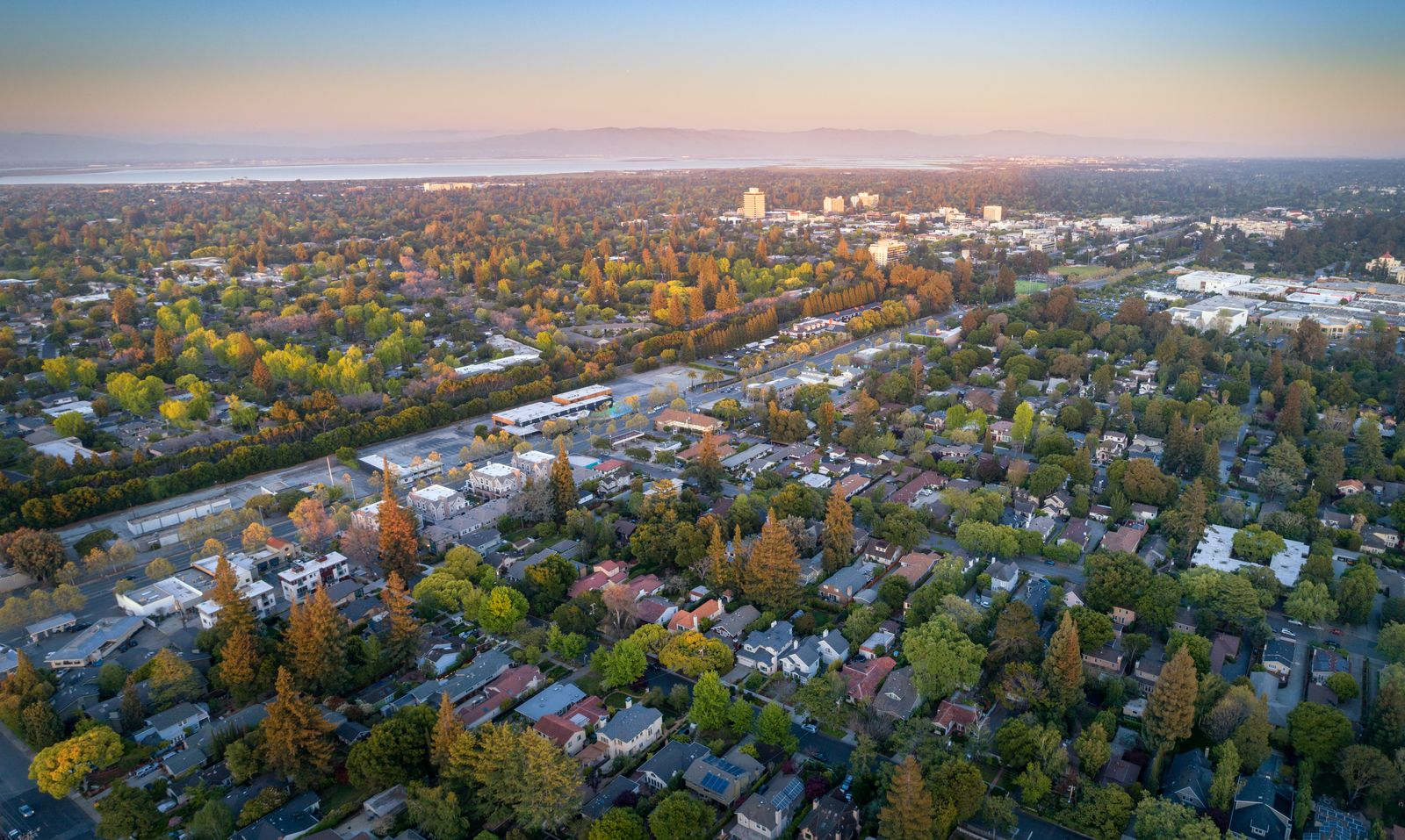 Aerial: Menlo Park suburbs in Silicon Valley at sunset