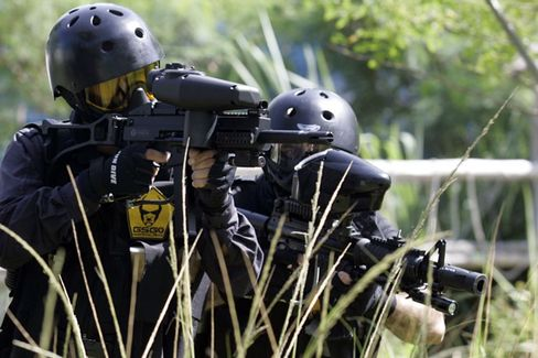 Members of GSG9 paintball team take up positions during a training session in Rio de Janeiro. The team named itself after Germany's elite GSG-9 anti-terrorism force. Will these players soon be forced to give up their game?
