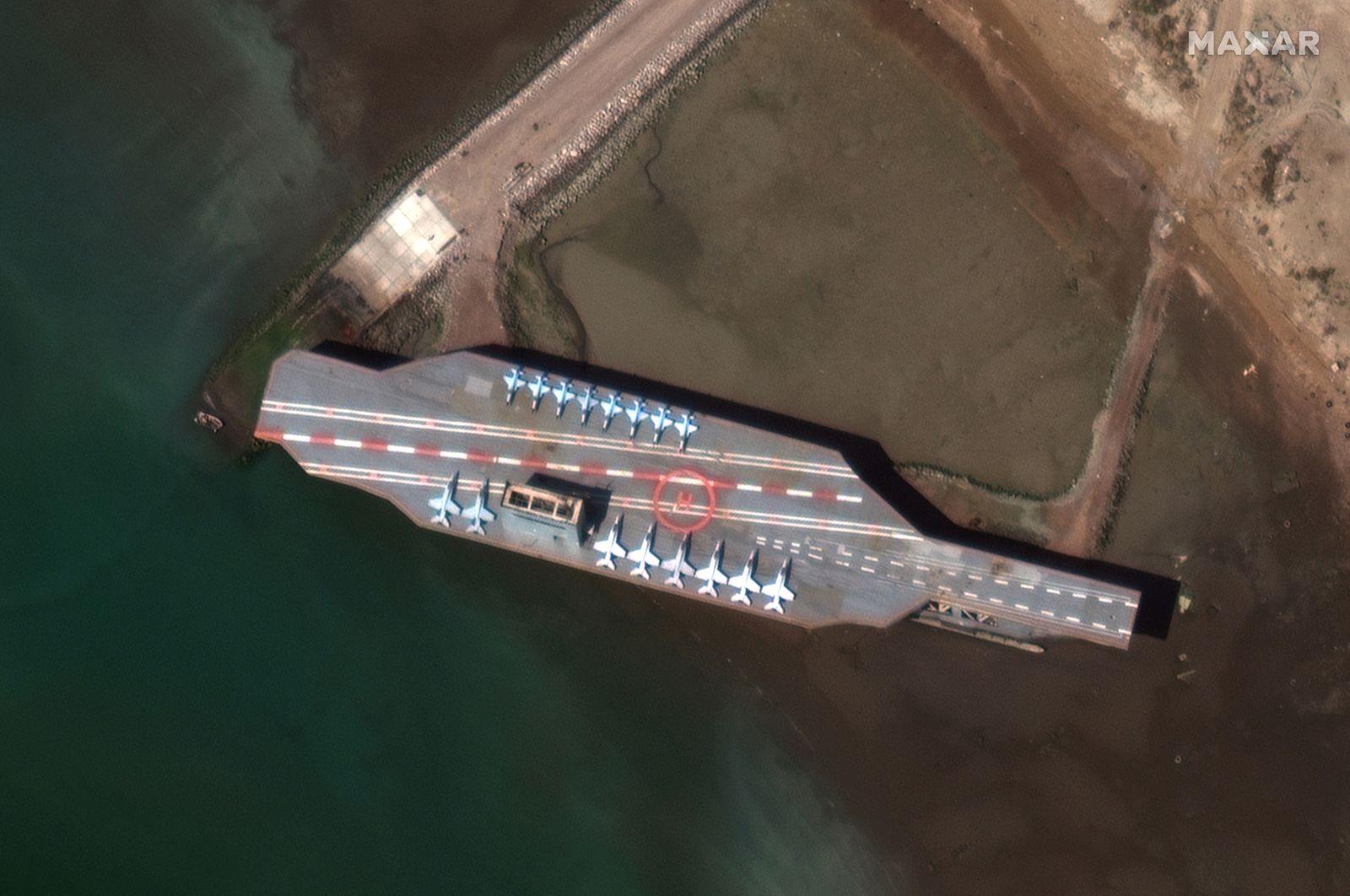 Iran's refurbished mockup aircraft carrier is seen at its home port of Bandar Abbas