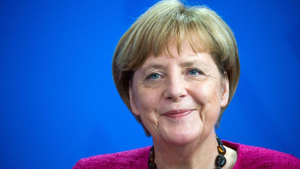 Gipfel und Co.: Merkel, allein unter Männern