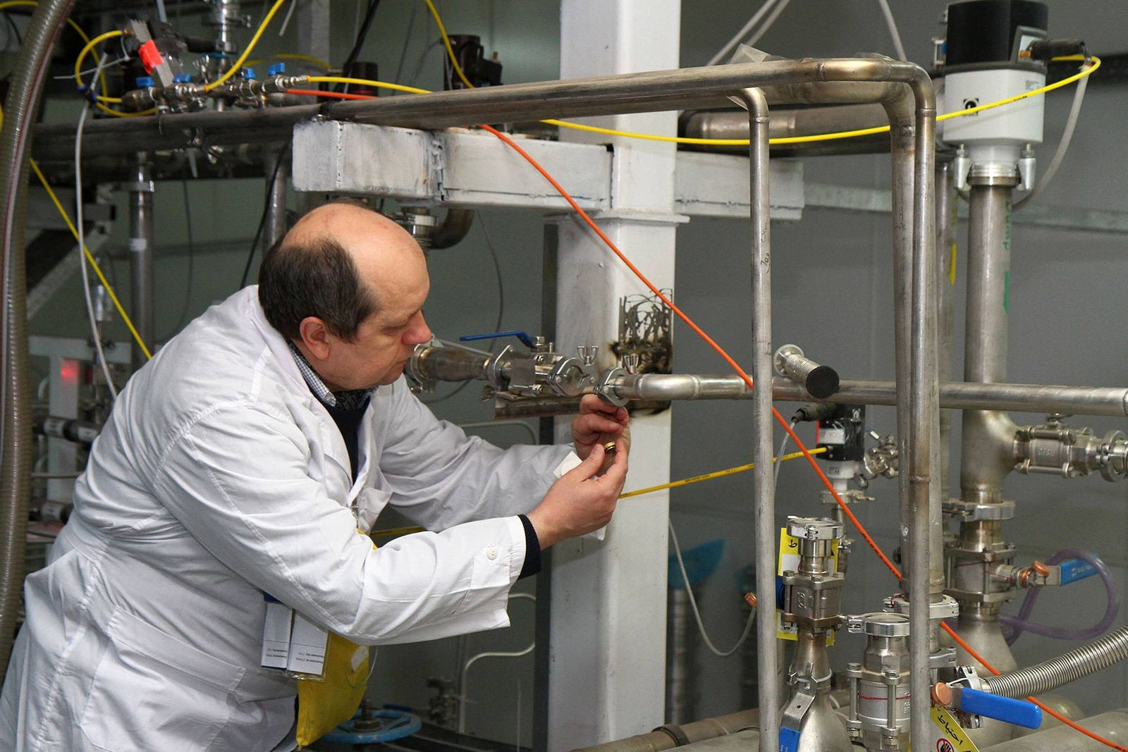 A Member of the IAEA inspection team examines the process inside Natanz uranium enrichment plant on January 20, 2014 in