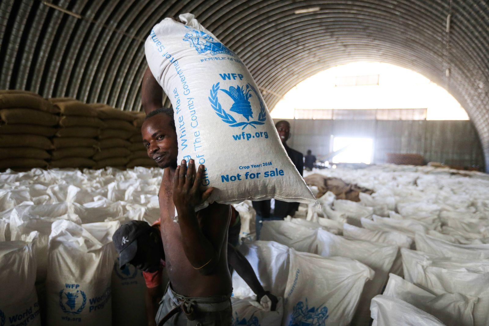 (170303) -- MARALAL, March 3, 2017 -- A worker transfers relief food in Maralal town, Samburu County, Kenya, on March 2