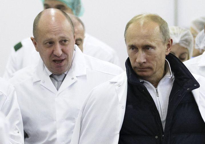 Jewgeni Prigoschin (l.) mit dem russischen Präsidenten Wladimir Putin