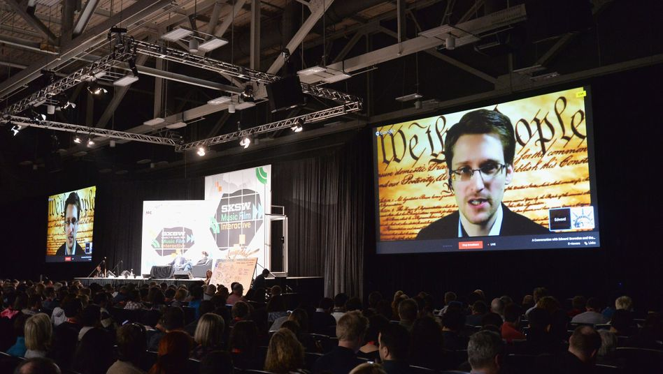 NSA whistleblower Edward Snowden speaks via video conference at the South by Southwest Festival in Austin, Texas, in early March.