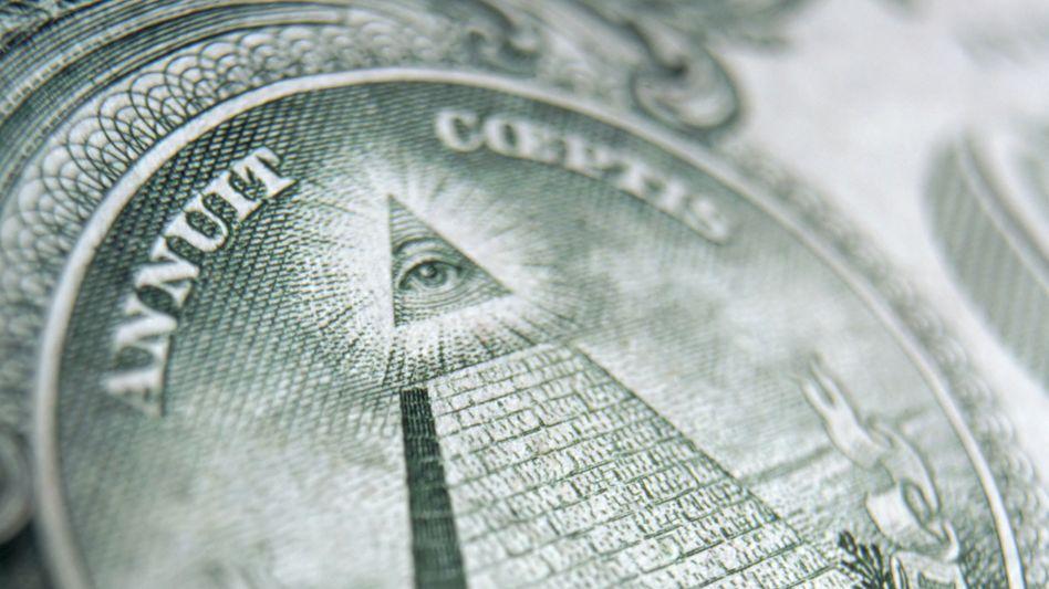 Detail auf Dollarnote: Geldauge sei wachsam!