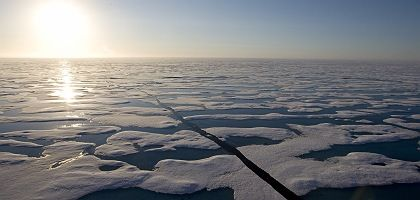 The trail of a Candadian Coast Guard icebreaker can be seen in the icy waters of Resolute Bay.