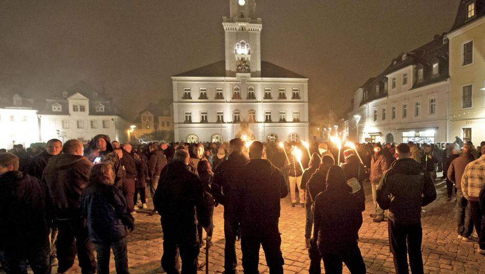 NPD supporters rally with torches during a demonstration against a refugee home in the eastern German town of Schneeberg. A new attempt to ban the party will soon make its way to the German Constitutional Court.
