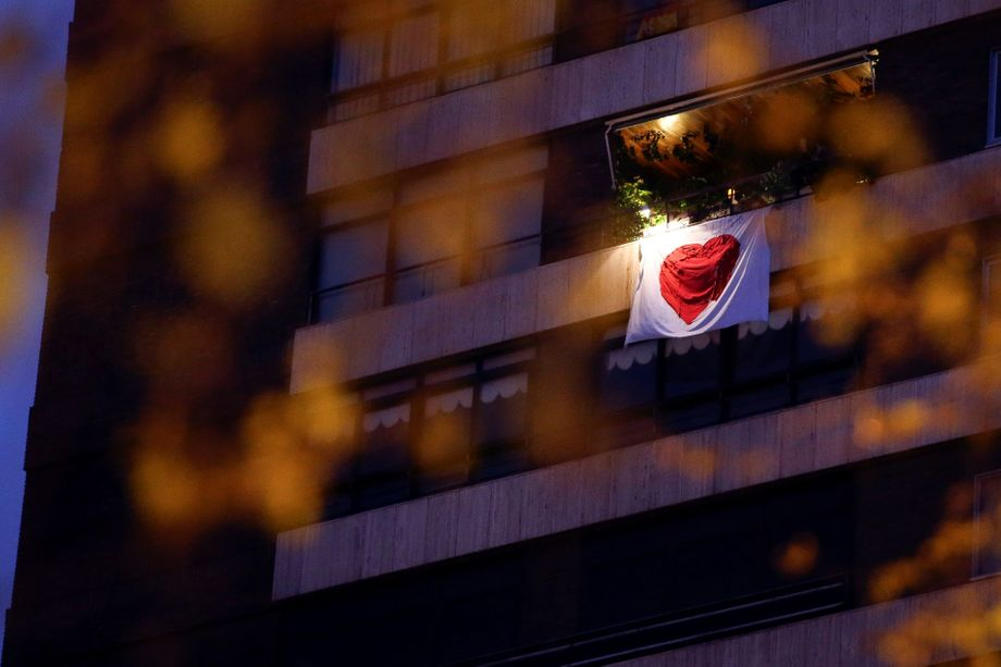 Residents of Madrid who live adjacent to a hospital hung a banner with a heart on it.