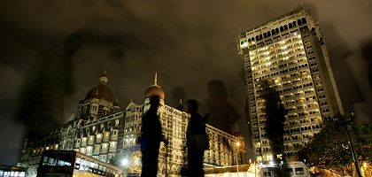 Indian paramilitary soldiers stand guard in front of the Taj Mahal hotel in Mumbai.