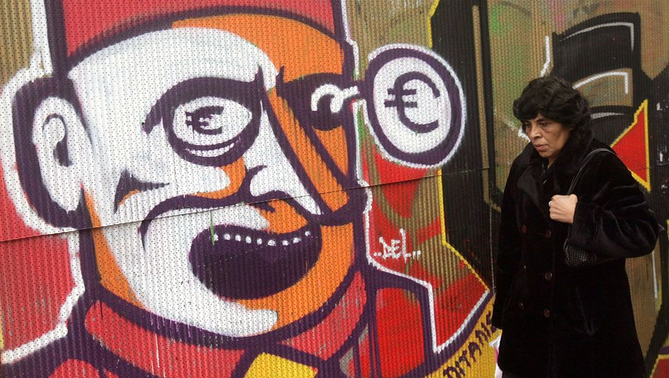 An anti-capitalist piece of graffiti in Athens: Greece's debt crisis is just one of the euro zone's many problems.