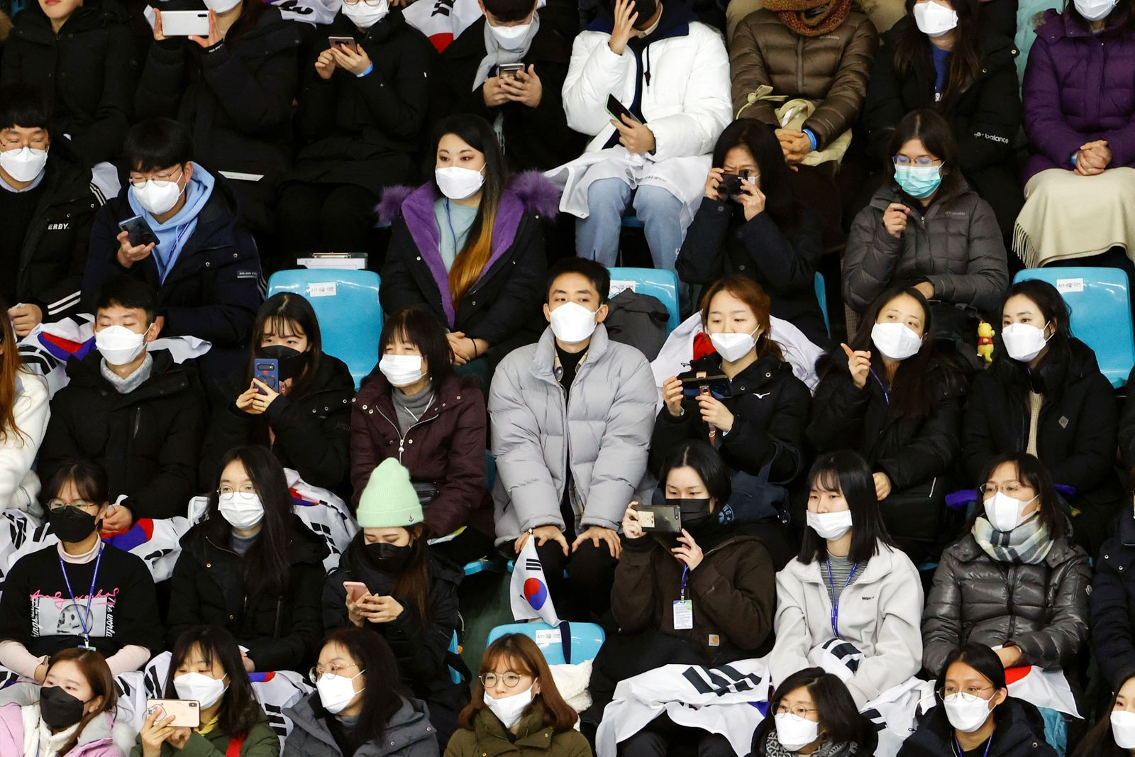 Spectators wear masks to prevent contacting a new coronavirus during Four Continents Figure Skating Championships 2020 in Seoul