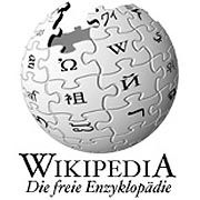 Wikipedia Germany is back online, but it still faces a legal challege from the parents of a deceased hacker.