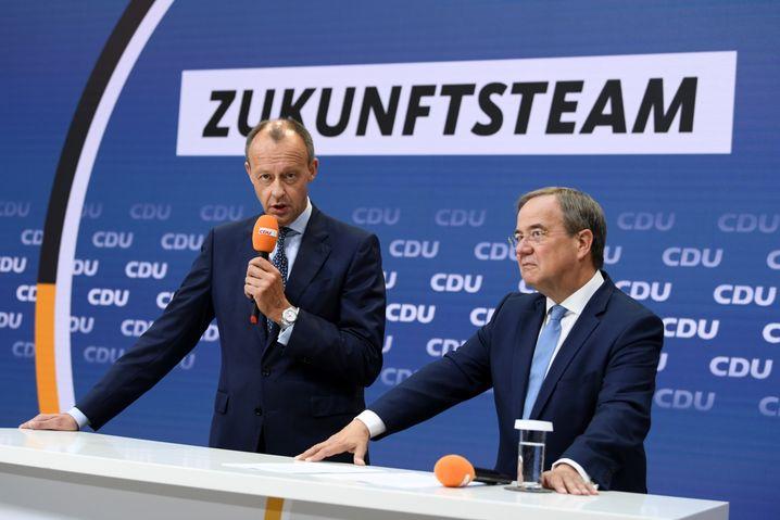 Friedrich Merz (l.) und Unionskanzlerkandidat Armin Laschet