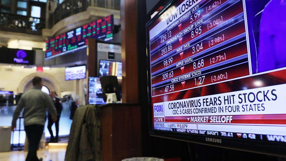Börse in New York (Archivbild): Das Virus stellt laut Fed ein neues Risiko dar