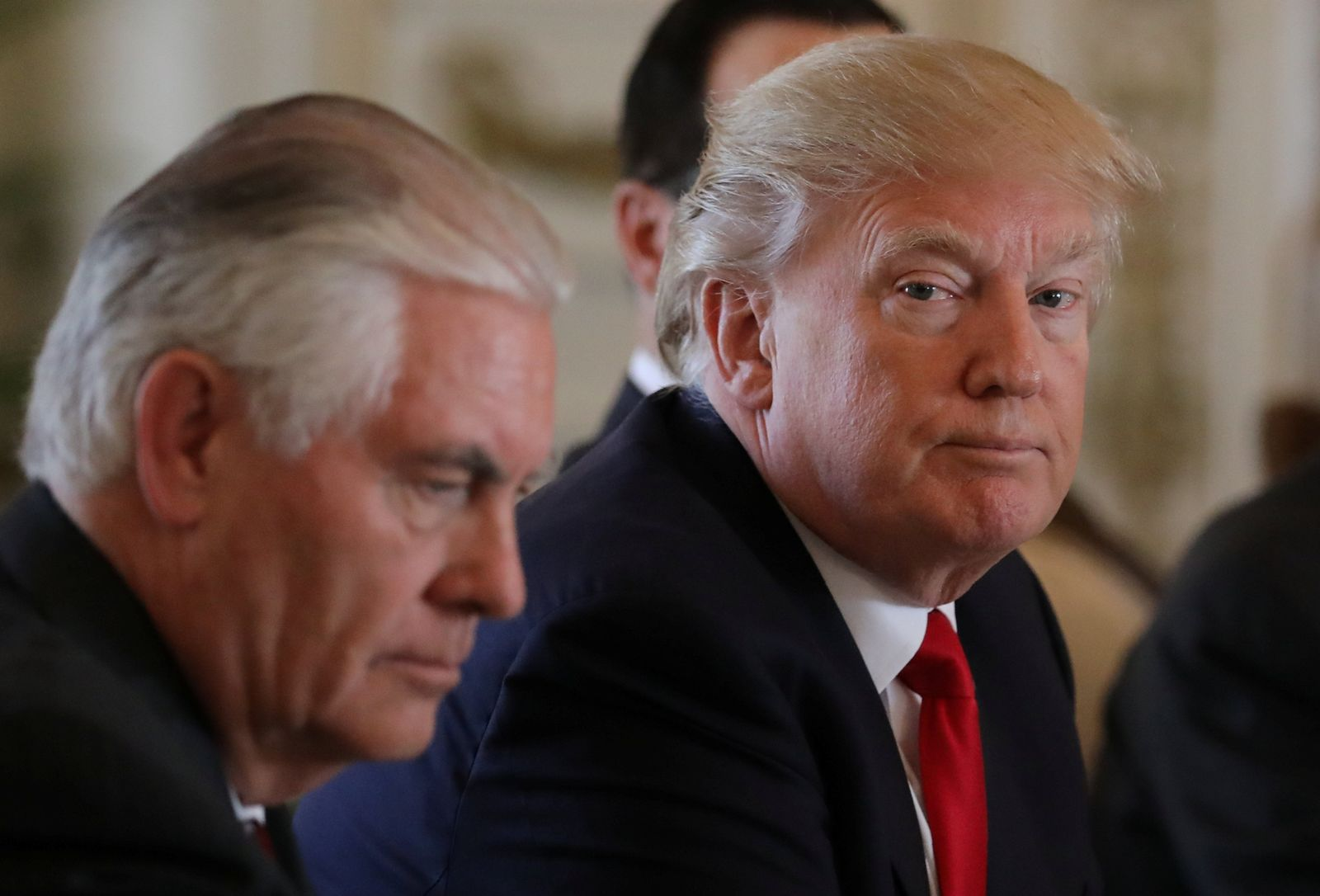 U.S. President Trump sits next to Tillerson during bilateral meeting with China's President Xi at Trump's Mar-a-Lago estate in Palm Beach