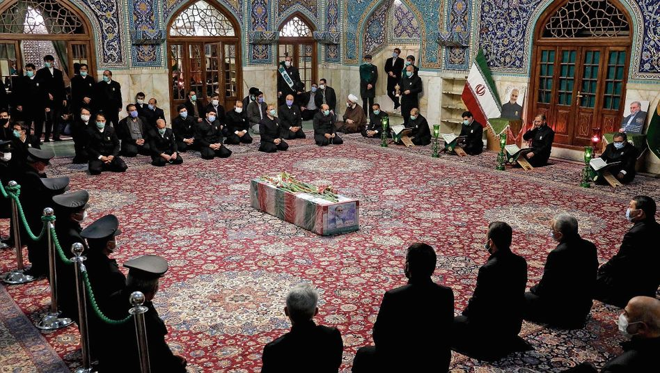 """Mourners praying at the coffin of assassinated nuclear physicist Mohsen Fakhrizadeh: """"We are furious."""""""