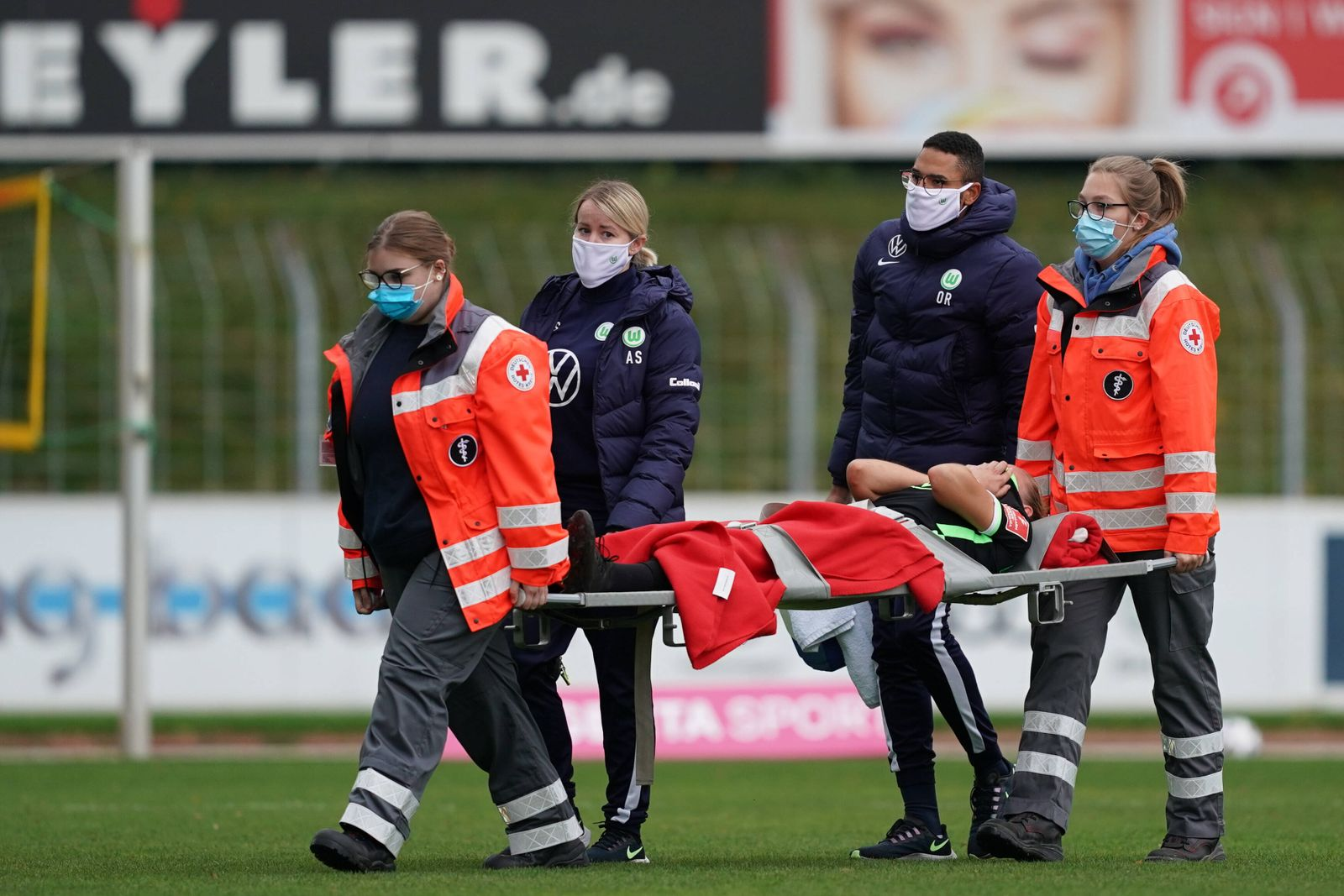 FREIBURG, GERMANY OCT 11TH: Alexandra Popp ( 11 Wolfsburg) getting taken from the field after a foul and inury during t