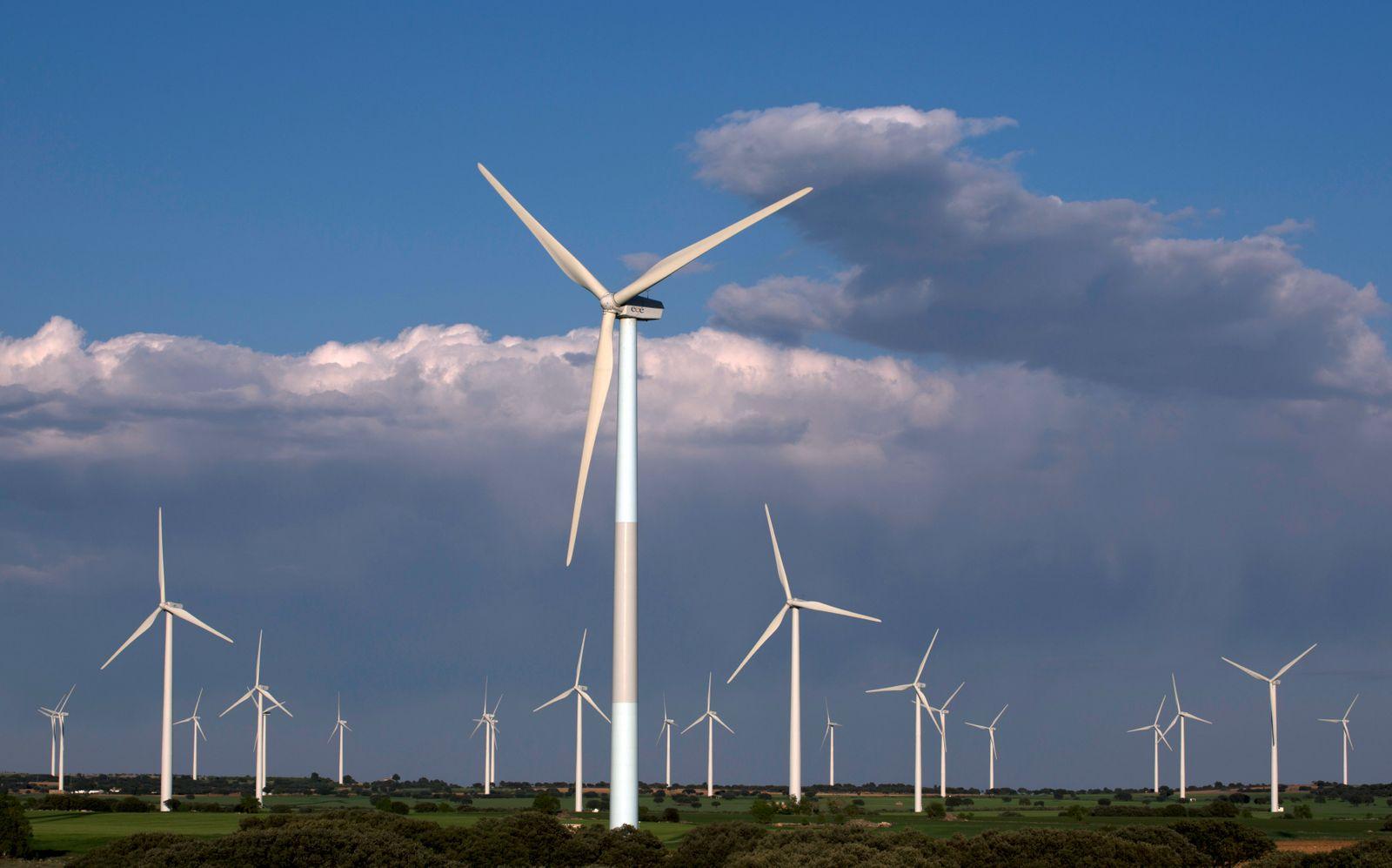 Wind turbines are seen in a field in Tebar