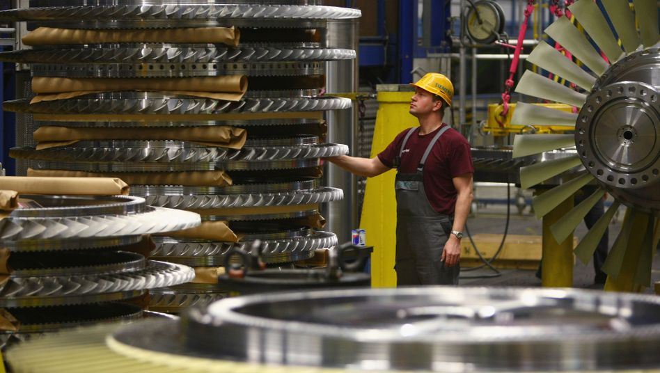 A worker in a gas turbine factory in Berlin: Even German companies aren't investing enough.
