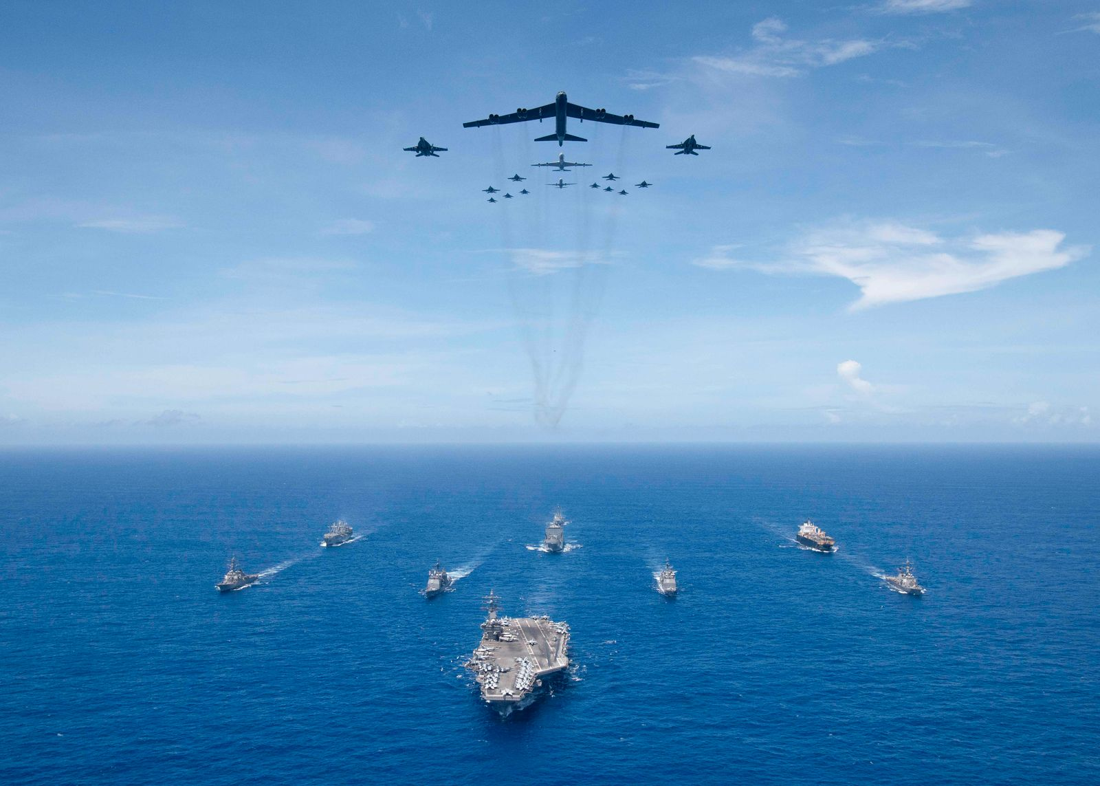 USS Ronald Reagan leads a formation of Carrier Strike Group 5 for a photo exercise.