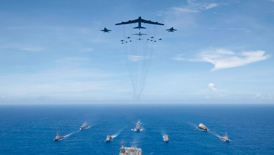 """The aircraft carrier USS Ronald Reagan and U.S. Air Force jets: """"It would be foolish to put our hands over our eyes and say China is not going to be a problem."""""""