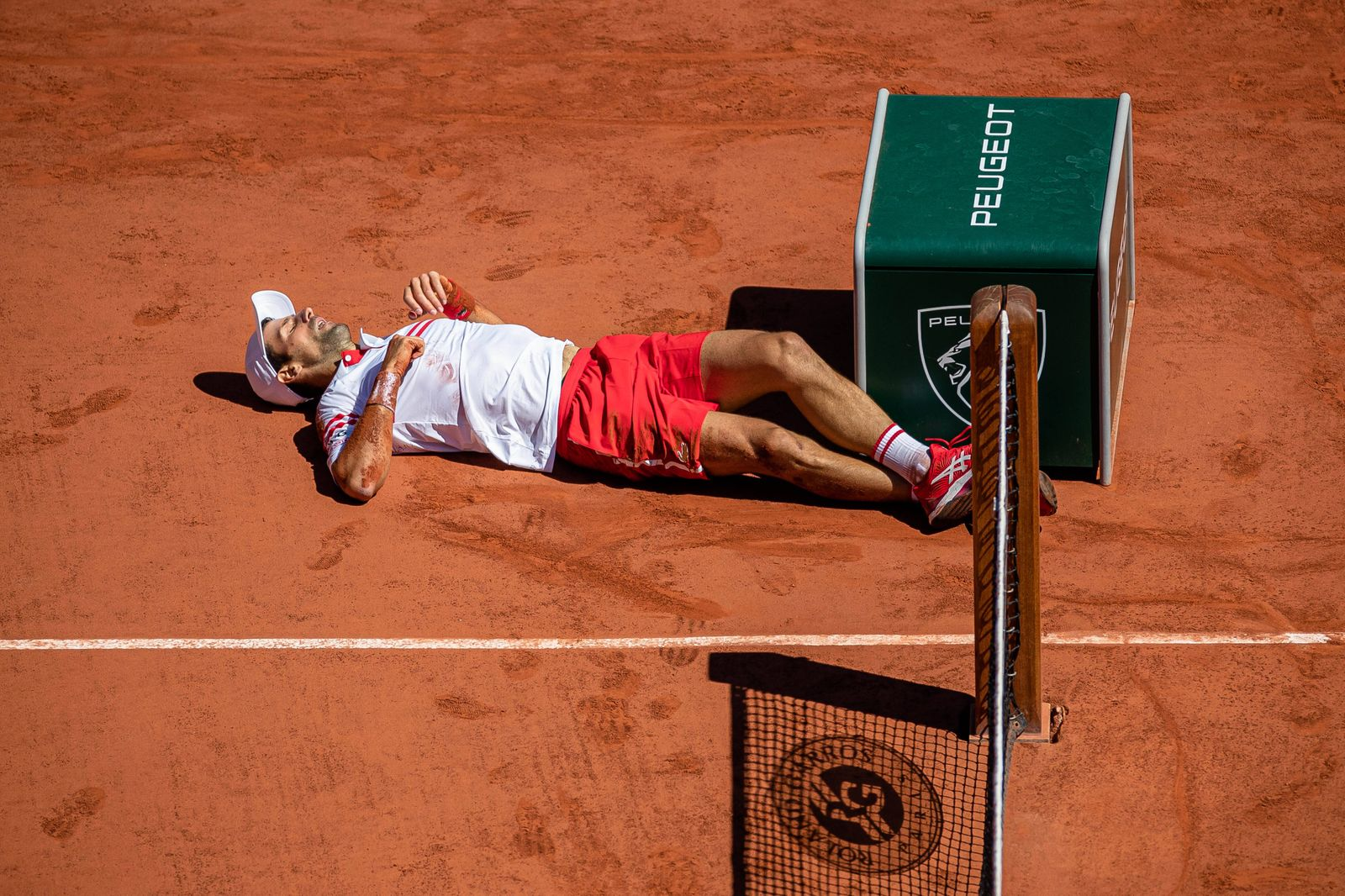 Novak DJOKOVIC of Serbia falls to the ground during his men s single against Stefanos TSITSIPAS of Greece on the Men s