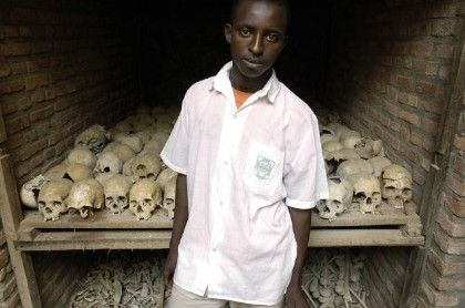 Romain Ngoga, 17, stands outside a church where the skulls and bones of some of those killed in the genocide are stored.