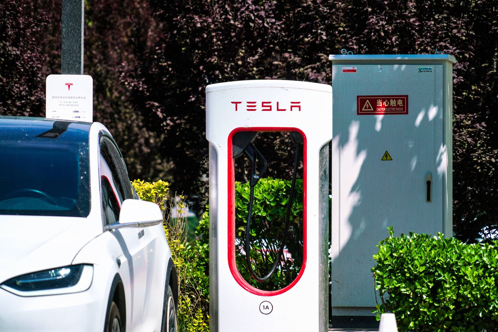 BEIJING, CHINA - MAY 17: A Tesla Model 3 charges at a Tesla Supercharger station on May 17, 2021 in Beijing, China. PUBL