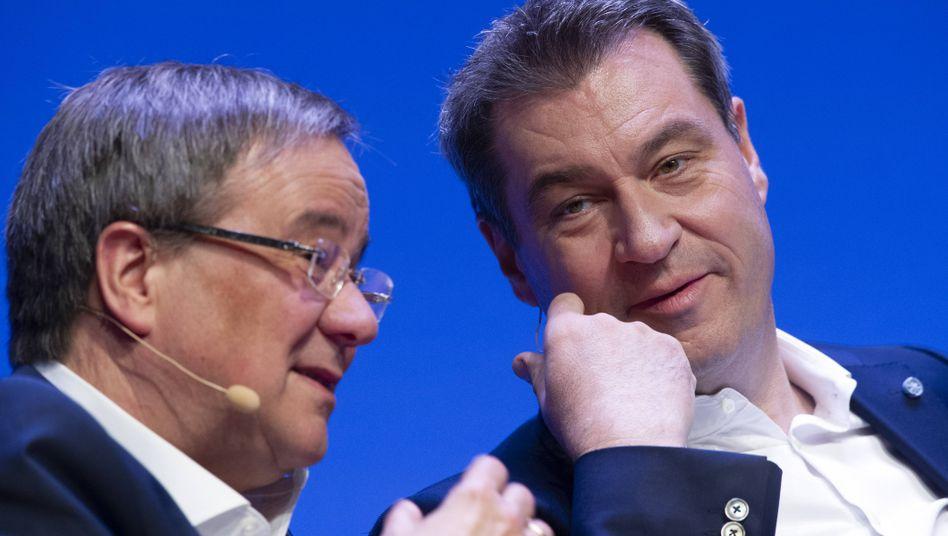 Einer von ihnen wird Kanzlerkandidat: Armin Laschet (l.) und Markus Söder