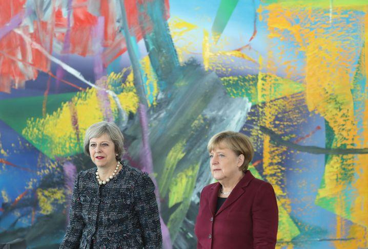 Britische Premierministerin May und Merkel