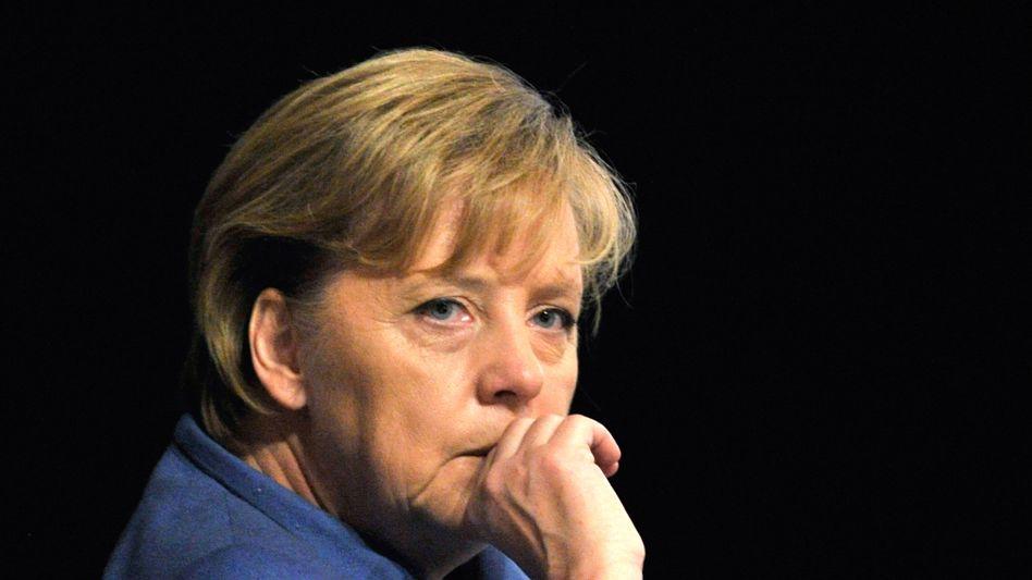 Kanzlerin Merkel: Die Mehrheit wackelt