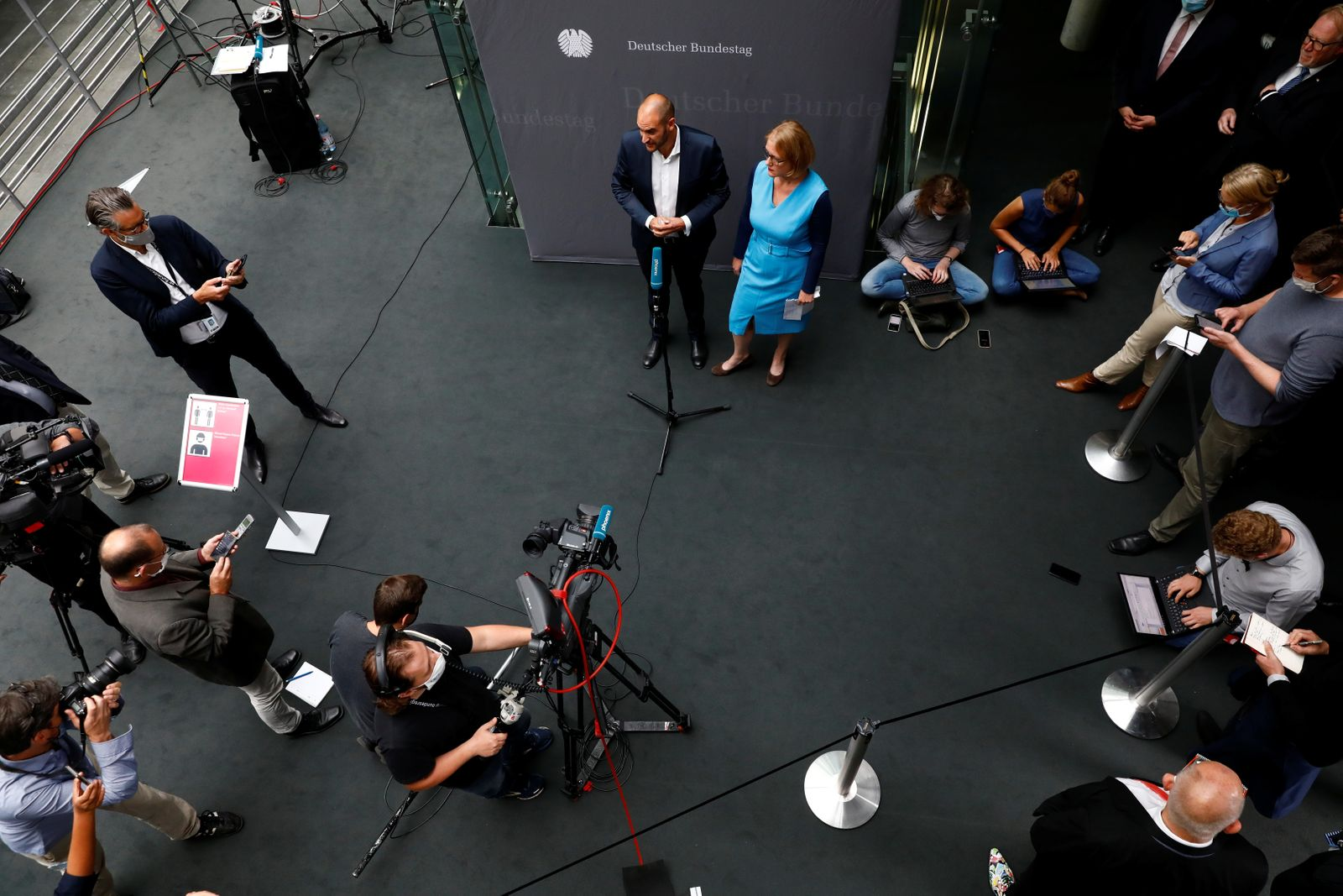 Germany's Green Party Bundestag Member Danyal Bayaz and Lisa Paus of the Green party, give a statement to the media, after an extraordinary meeting on the Wirecard scandal held by the German parliament's financial committee, in Berlin