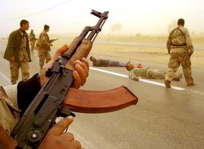 Irakischer Soldat, irakische Militante in Nadschaf: Sunniten oder Schiiten?