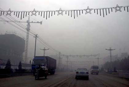 Pollution in China: Climate change is real, and it is overwhelmingly manmade.