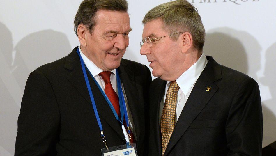 Schröder mit IOC-Chef Bach: Lob für die Ausrichter