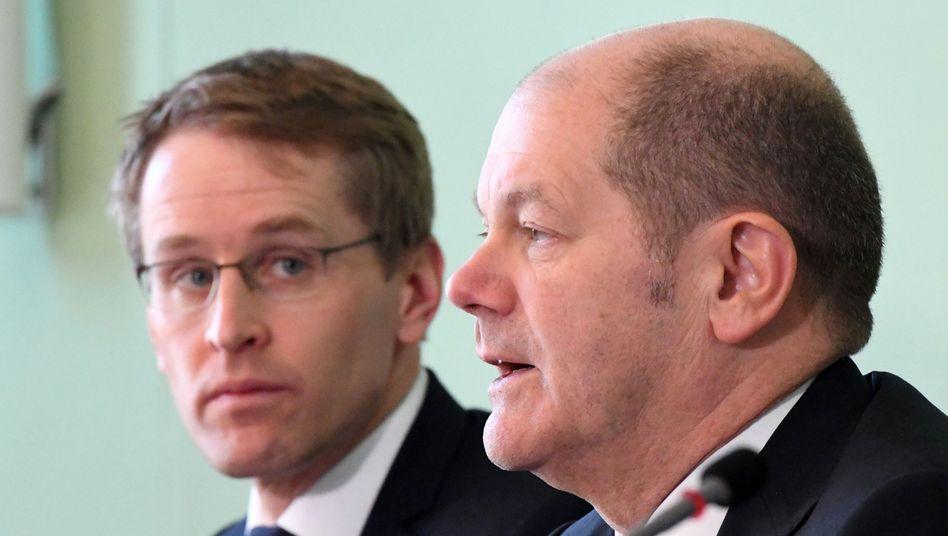 Daniel Günther (l.) und Olaf Scholz (SPD)