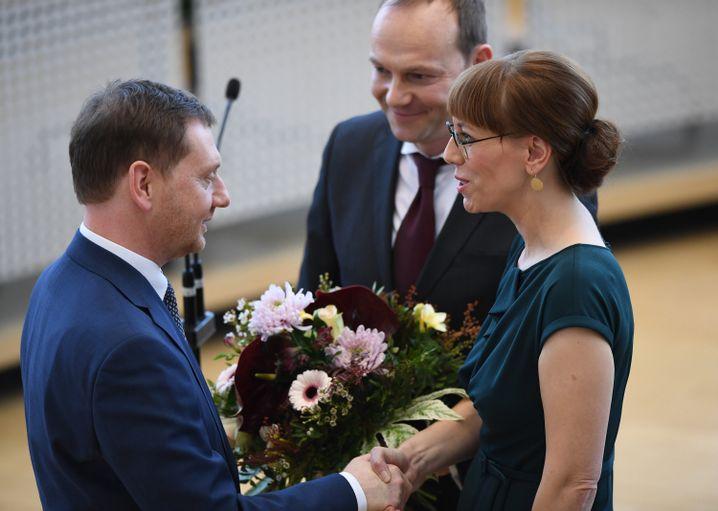 Sachsens CDU-Ministerpräsident Michael Kretschmer (l.), Grünen-Justizministerin Katja Meier