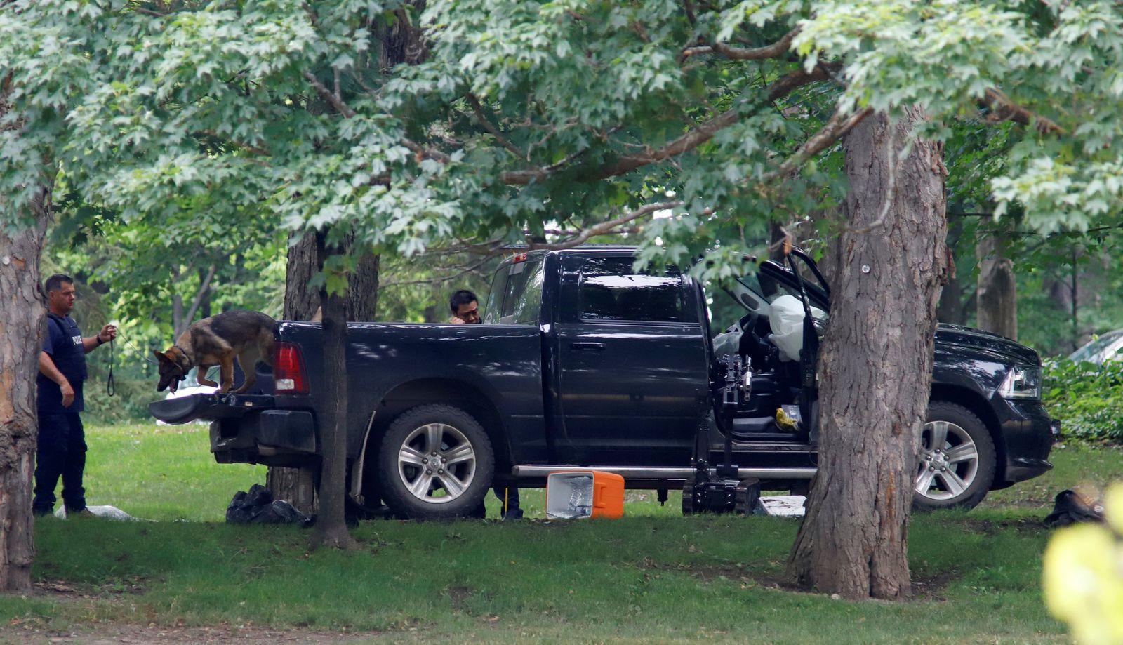 A police dog searches a vehicle at Rideau Hallin Ottawa