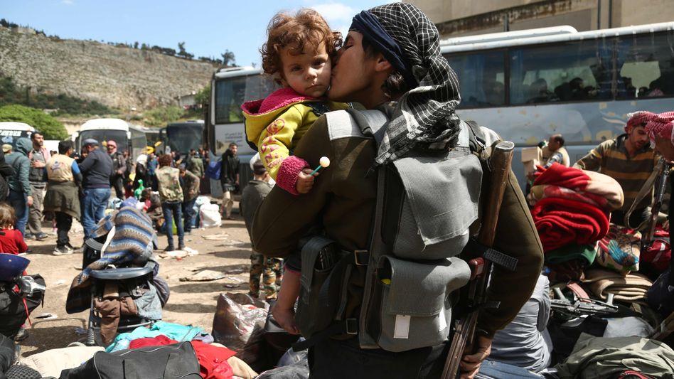 Evakuierung von Rebellen und Zivilisten in Ost-Ghuta