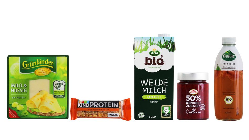 """Die Windbeutel-Nominierungen: """"Grünländer Käse"""" von Hochland, """"Be-Kind Proteinriegel"""" von Mars, Bio-""""Weidemilch"""" von Arla, Fruchtaufstrich """"50% weniger Zucker"""" von Zentis und der """"Volvic Bio Rooibos Tee"""" von Danone Waters"""