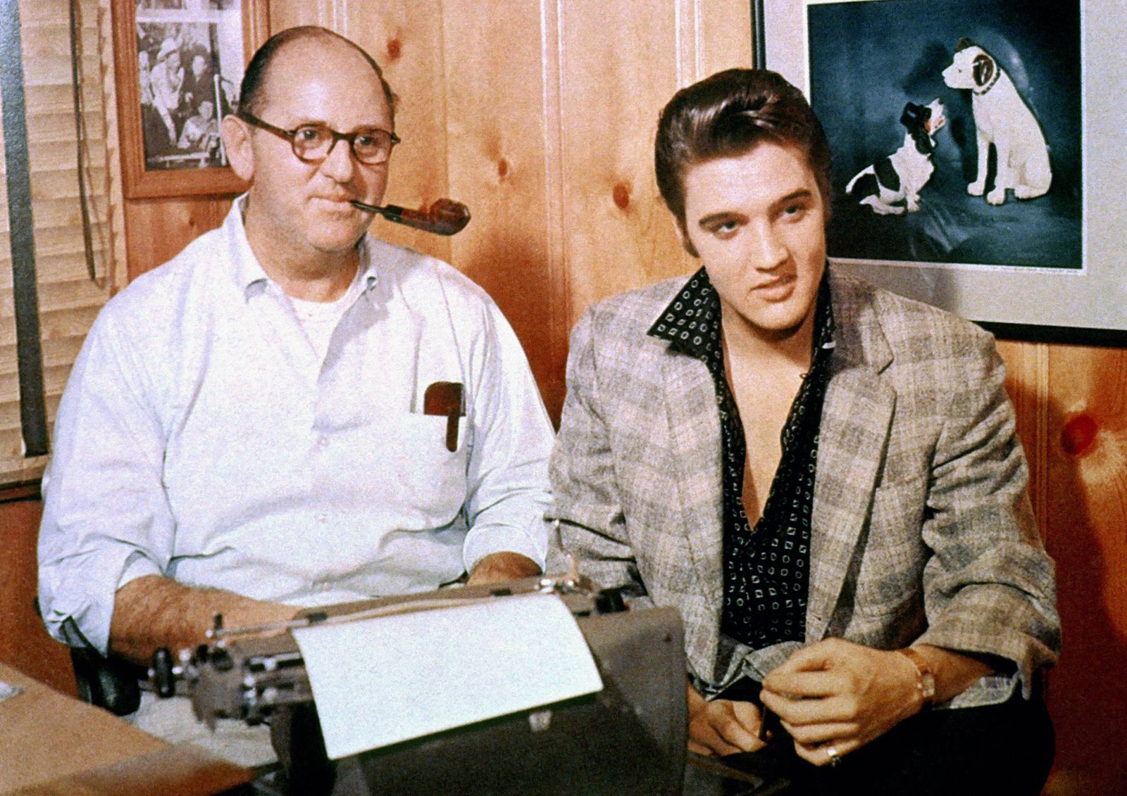 Elvis Presley with his manager Colonel Tom Parker signing a record contract with RCA Victor Octob