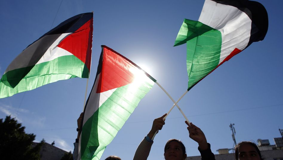 Palestinians demonstrate in the West Bank in support of their bid for recognition of statehood at the United Nations.