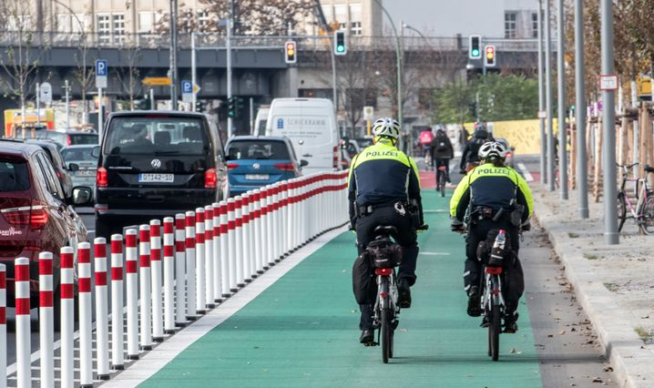 In 2018, the city of Berlin opened its first street bicycle path that is protected from neighboring drivers.
