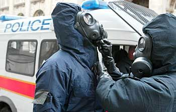 Police officers in chemical suits arrive in the area of Bank Underground station as part of the 2003 exercise.