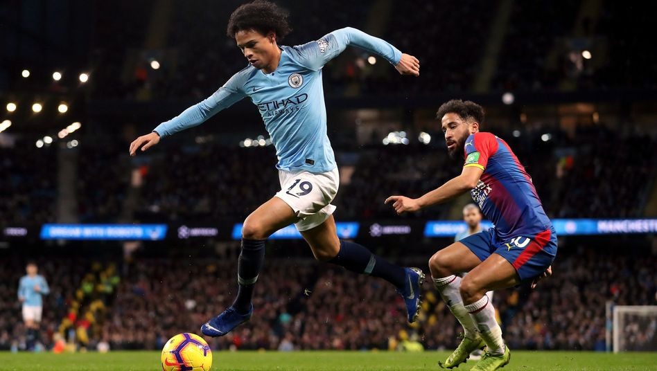 Manchester City's Leroy Sané (left)