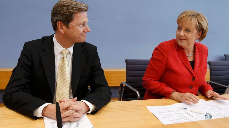 """Koalitionspolitiker Westerwelle und Merkel: """"Einmaliger Kraftakt"""""""