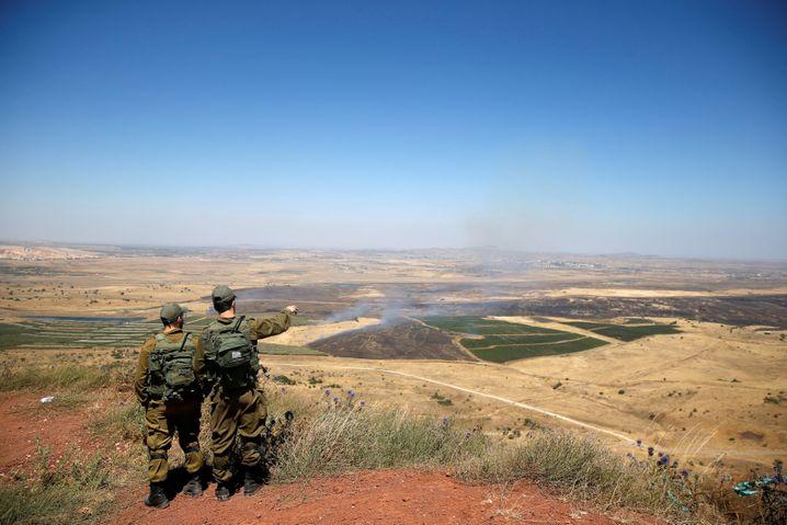 Israelische Soldaten auf den Golanhöhen: Nach internationalem Recht gelten die Gebiete als von Israel besetztes Territorium Syriens