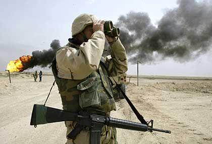A burning oilfield in Iraq in 2003