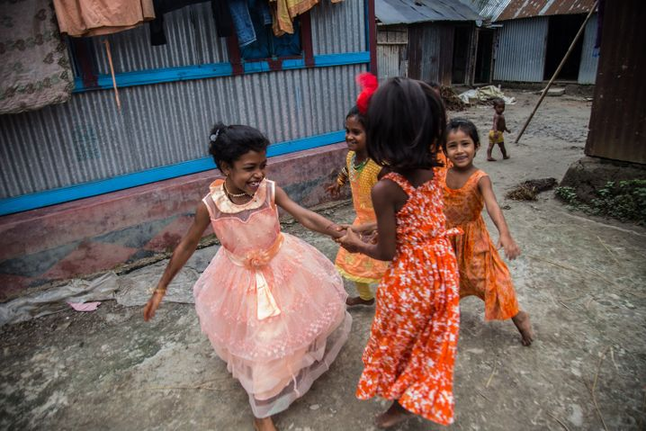 Tasnia Begum's daughter, Mim, plays with friends on Eid.
