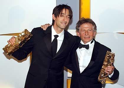Strahlende Sieger: Polanski und sein Hauptdarsteller Adrien Brody (l.)